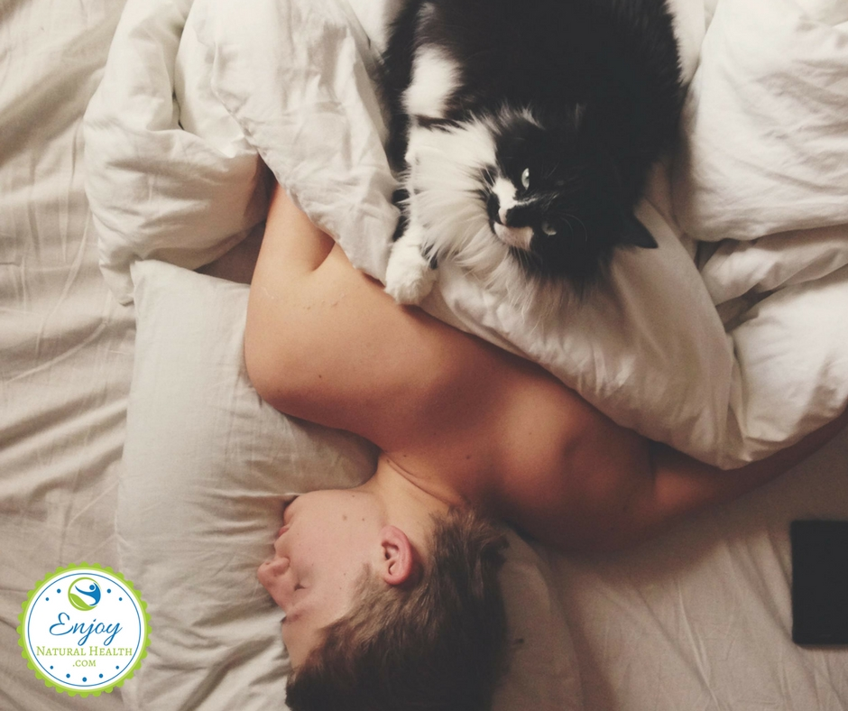 sleep mistakes: cat sleeping on top of man