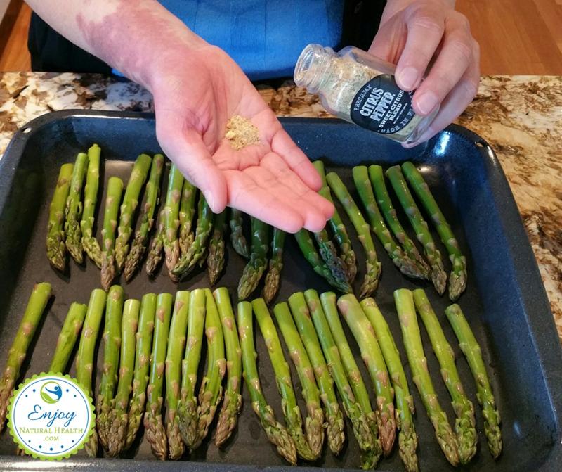 Seasoning asparagus wiht FreshJax citrus pepper spice